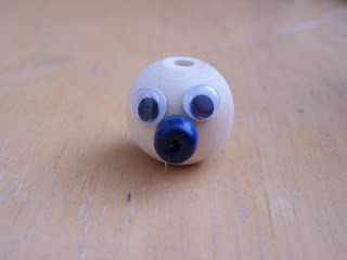 Funny figures made of wooden beads