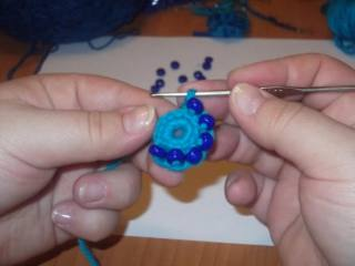 Hook and beads. Knit flower