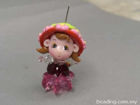 Мила лялечка з намистин