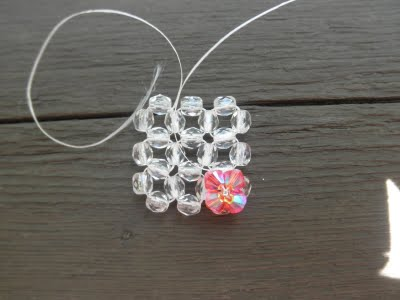 A ring of beads and bicone Swarovski