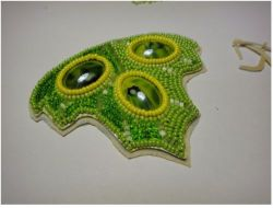 Pendant in the form of a leaf